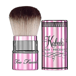 Sephora's Too Faced Retractable Kabuki Brush is black, pinky, stripey and French in feel. $32.