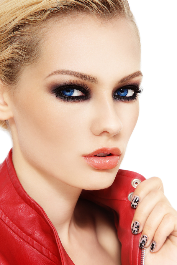 Portrait of young beautiful blond woman with smokey eyes