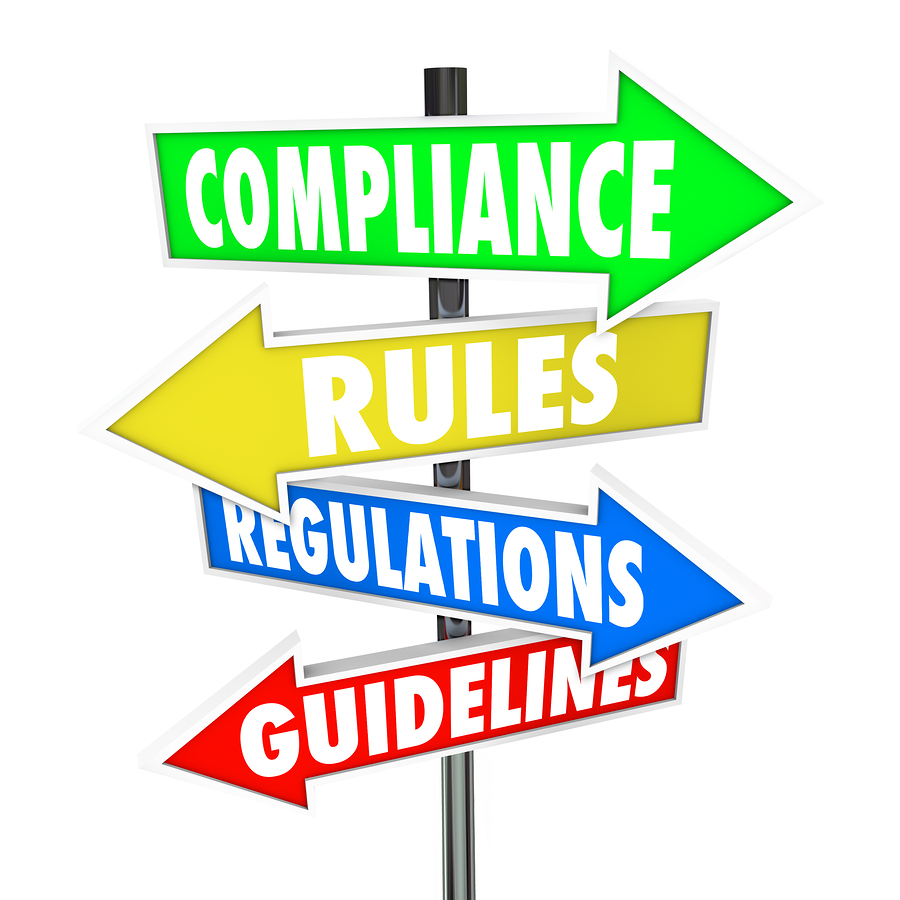 The words Compliance, Rules, Regulations and Guidelines on color